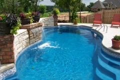 Elegant fiberglass pool with water fall.