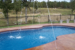 Fiberglass pool with fun water fountains.