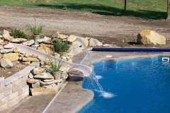 Fiberglass Pool with waterslide and fun fountain features.
