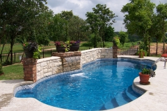Fiberglass pool beautifully landscaped.