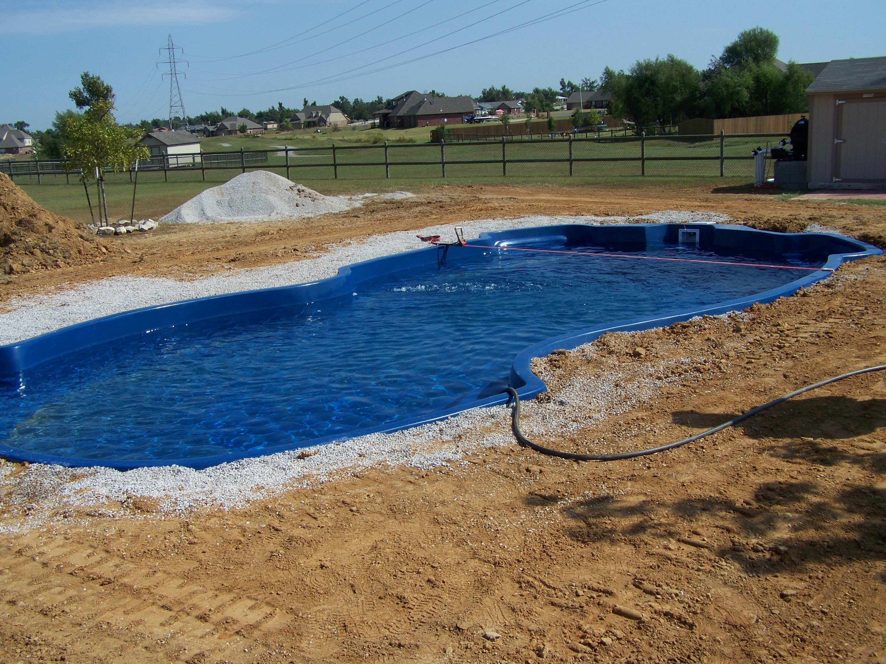Fiberglass pool breaking ground swimming pool contractor - Swimming pool contractors oklahoma city ...